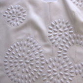 Karen Nicol is a textile designer who uses an embellisher to give a unique quality to her work