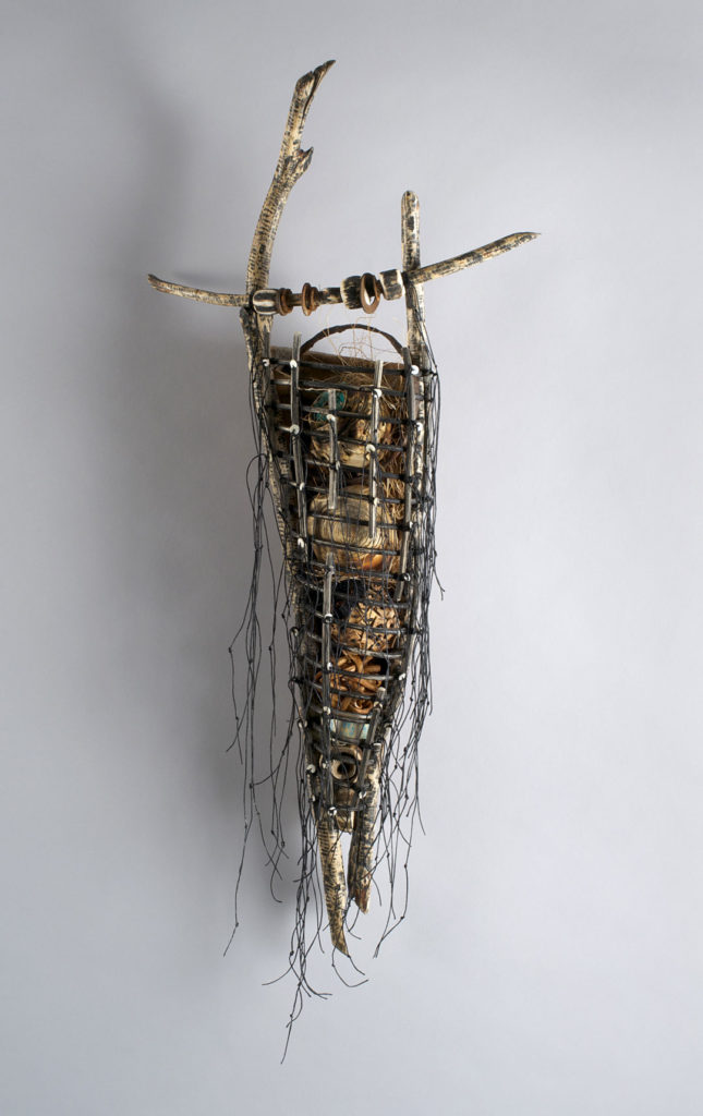 Talisman 2013 34″ x 15″ x 7″ Beaver sticks, woven frame of willow, waxed linen thread, clam shell beads. Caged objects woven, stitched, carved, beaded of Pacific Bullwhip sea kelp, reclaimed beach metals