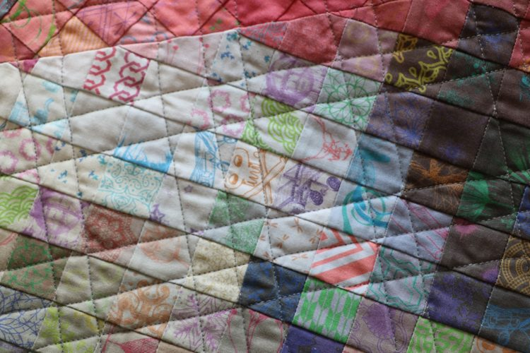 Greg Climer: Rescue Worker at factory collapse at Rana Plaza (Detail), 2016, Pieced and quilted cotton fabric