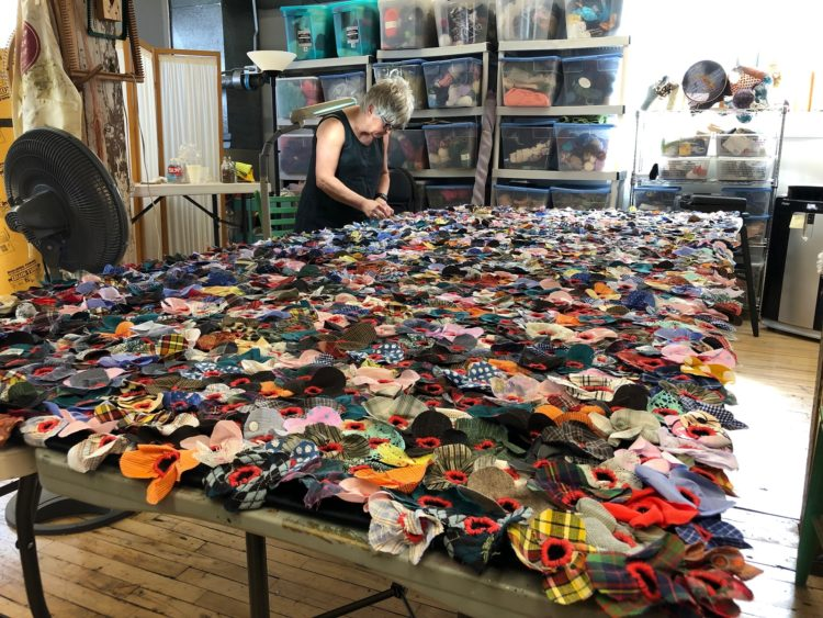 Jodi Colella: Once Was (in progress), 2019, 12 ft x 5 ft, Donated clothing, black velvet foundation, red embroidery cotton