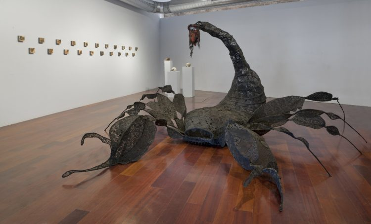 Jodi Colella: Stinger, 2018, 7 h x 17 w x 24 d feet, 9 gauge wire, lace, doilies dyed black and assembled with thread onto the armature