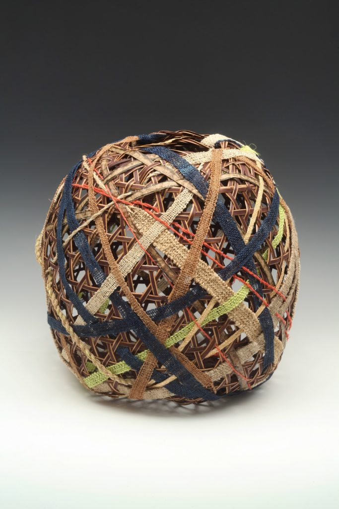 """Barbara Shapiro: Strength in Diversity, 2019, 12 x 12 x 12"""", plaited sedori cane, handwoven bands of 10 different bast fibers and paper. Photo credit, Don Felton"""